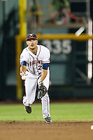 Virginia Cavaliers shortstop Daniel Pinero (22) tosses the ball to second base during the NCAA College baseball World Series against the Florida Gators on June 15, 2015 at TD Ameritrade Park in Omaha, Nebraska. Virginia defeated Florida 1-0. (Andrew Woolley/Four Seam Images)