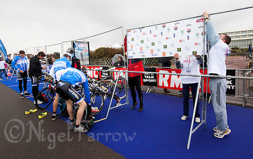 28 APR 2012 - LES SABLES D'OLONNE, FRA - Event crew fix team boards to the racking as teams prepare in transition for the prologue round of the French Grand Prix Series triathlon in Les Sables d'Olonne, France (PHOTO (C) 2012 NIGEL FARROW)