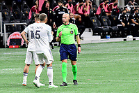 ATLANTA, GA - APRIL 24: Referee Allan Chapman discusses a foul with Chicago defender #5 Francisco Calvo during a game between Chicago Fire FC and Atlanta United FC at Mercedes-Benz Stadium on April 24, 2021 in Atlanta, Georgia.