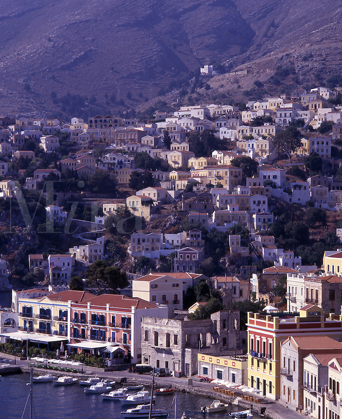 Greek town of Symi on hillside, overlooking harbor and boats. The Southern Dodecanese Islands. Greece europe.
