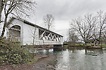 Larwood Covered Bridge, spanning Crabtree Creek near the Roaring River in Linn County, Oregon.  Circa 1939 this bridge replaced the original 1893 structure.  An old water powered mill sits along the bank.