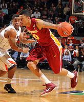 Dec. 30, 2010; Charlottesville, VA, USA; Iowa State Cyclones guard Diante Garrett (10) drives past Virginia Cavaliers guard Jontel Evans (1)  during the game at the John Paul Jones Arena. Mandatory Credit: Andrew Shurtleff