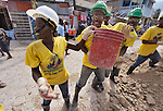 Earthquake survivors in the Haitian capital of Port-au-Prince clean up rubble in a cash-for-work program.