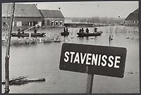Flood of 1953. Flood  residents with boats return home to Stavenisse.,Holland<br /> <br /> Date: February 17, 1953