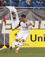 Real Salt Lake midfielder Javier Morales (11) crosses the ball. In a Major League Soccer (MLS) match, Real Salt Lake (white)defeated the New England Revolution (blue), 2-1, at Gillette Stadium on May 8, 2013.