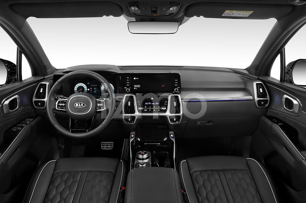 Stock photo of straight dashboard view of 2021 KIA Sorento-Hybride Sense 5 Door SUV Dashboard