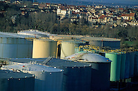 Cluster of industrial oil tanks next to a residential area, Paris, France.
