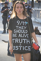 An unidentified spectator with a message at the National September 11 Memorial on the 20th anniversary of the September 11, 2001 terrorist attack on the World Trade Center and the Pentagon in New York, New York, on Saturday, September 11, 2021.<br /> CAP/MPI/RS<br /> ©RS/MPI/Capital Pictures
