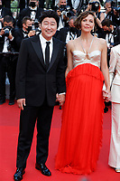 """CANNES, FRANCE - JULY 17: Jury members : Song Kang-Ho and Maggie Gyllenhaal at the final screening of """"OSS 117: From Africa With Love"""" and closing ceremony during the 74th annual Cannes Film Festival on July 17, 2021 in Cannes, France. <br /> CAP/GOL<br /> ©GOL/Capital Pictures"""