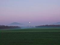 Moonrise over a Tuscan landscape