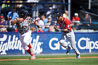 New Hampshire Fisher Cats third baseman Jason Leblebijian (8) chases down Jake Fox (34) in a run down during a game against the Reading Fightin Phils on June 6, 2016 at FirstEnergy Stadium in Reading, Pennsylvania.  Reading defeated New Hampshire 2-1.  (Mike Janes/Four Seam Images)