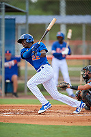 GCL Mets designated hitter Jaylen Palmer (22) follows through on a swing during a game against the GCL Marlins on August 3, 2018 at St. Lucie Sports Complex in Port St. Lucie, Florida.  GCL Mets defeated GCL Marlins 3-2.  (Mike Janes/Four Seam Images)