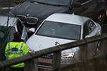 © Joel Goodman - 07973 332324 . 03/01/2017. Huddersfield, UK. A bullet riddled silver Audi car at the slip road at Junction 24 of the M62 motorway in Huddersfield . West Yorkshire police have announced a man has died following the discharge of a police firearm , during what they describe as a pre-planned operation , yesterday evening (2nd January 2017) . Photo credit : Joel Goodman