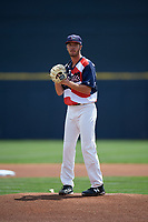 Quad Cities River Bandits starting pitcher Peter Solomon (18) gets ready to deliver a pitch during a game against the West Michigan Whitecaps on July 23, 2018 at Modern Woodmen Park in Davenport, Iowa.  Quad Cities defeated West Michigan 7-4.  (Mike Janes/Four Seam Images)
