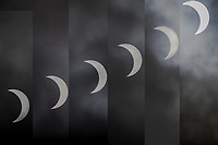 Six images captured through the clouds over a period of six minutes during the partial solar eclipse on August 21, 2017.