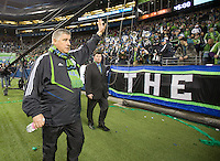 Sigi Schmid waves to the fans, in a 3-0 Seattle Sounders victory over the New Your Red Bulls, Thursday, March 19, 2009.