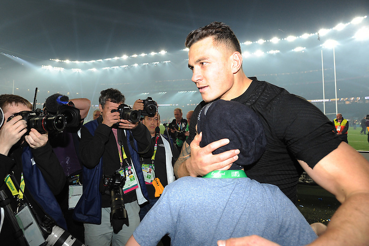 Sonny Bill Williams of New Zealand gives his winners' medal to Charlie Lines, a young All Blacks fan, during the Rugby World Cup Final between New Zealand and Australia - 31/10/2015 - Twickenham Stadium, London<br /> Mandatory Credit: Rob Munro/Stewart Communications