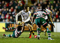 Photo: Richard Lane/Richard Lane Photography. Leicester Tigers v London Wasps. Aviva Premiership. 07/01/2012. Wasps' Elliot Daly passes as he breaks the tackle by Tigers' Matt Smith.