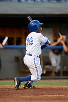 Bluefield Blue Jays second baseman Jose Theran (16) follows through on a swing during a game against the Bristol Pirates on July 26, 2018 at Bowen Field in Bluefield, Virginia.  Bristol defeated Bluefield 7-6.  (Mike Janes/Four Seam Images)