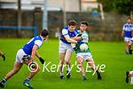 Tussle for possession between Diarmuid O'Sullivan of  Kerins O'Rahillys and Eoghan O'Sullivan of Killarney Legion in the Senior Club Football Championship