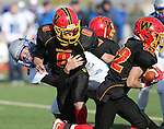 Pahranagat Valley's Jacob Roemer pressures Whittell quarterback Colin Buchholz as he hands off to Corey Huber during the second half of the NIAA DIV championship game against Whittell High at Dayton High School in Dayton, Nev., on Saturday, Nov. 21, 2015. PVHS won 54-28. (Cathleen Allison/Las Vegas Review Journal)
