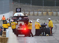 Feb 11, 2017; Pomona, CA, USA; NHRA funny car driver Robert Hight climbs from his car as members of the safety safari lift his California Highway Patrol themed body over the wall after a tire failure during qualifying for the Winternationals at Auto Club Raceway at Pomona. Mandatory Credit: Mark J. Rebilas-USA TODAY Sports