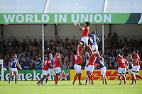 Joseph Tuineau of Tonga takes the lineout ball against Tjiuee Uanivi of Namibia during Match 20 of the Rugby World Cup 2015 between Tonga and Namibia - 29/09/2015 - Sandy Park, Exeter<br /> Mandatory Credit: Rob Munro/Stewart Communications