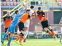 Dundee Utd's Nadir Ciftci uses his hand to knock the ball into the net and earns himself a second yellow and red card.