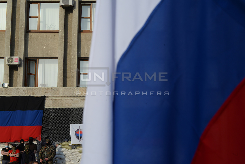 Russian flag seen on the square in front of the city hall in Slavyansk city as it is  taken by the protesters . Donetsk region. Ukraine