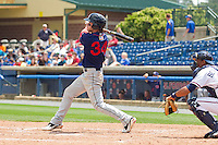 Bryce Harper #34 of the Hagerstown Suns follows through on his swing against the Rome Braves at State Mutual Stadium on May 2, 2011 in Rome, Georgia.   Photo by Brian Westerholt / Four Seam Images