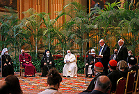 """Pope Francis listens as Joachim Von Braun, president of the Pontifical Academy of Sciences, addresses the meeting, """"Faith and Science: Towards COP26,"""" with religious leaders in the Hall of Benedictions at the Vatican Oct. 4, 2021. The meeting was part of the run-up to the U.N. Climate Change Conference, called COP26, in Glasgow, Scotland, Oct. 31 to Nov. 12, 2021."""