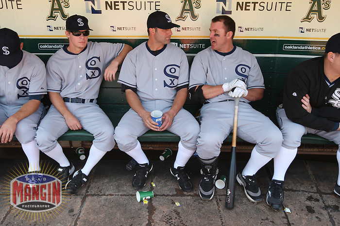 OAKLAND, CA - AUGUST 16:  From left: Chris Getz #17, Paul Konerko #14 and Jim Thome #25 of the Chicago White Sox get ready in the dugout before the game against the Oakland Athletics during the 1929-themed turn back the clock game at the Oakland-Alameda County Coliseum on August 16, 2009 in Oakland, California. Photo by Brad Mangin