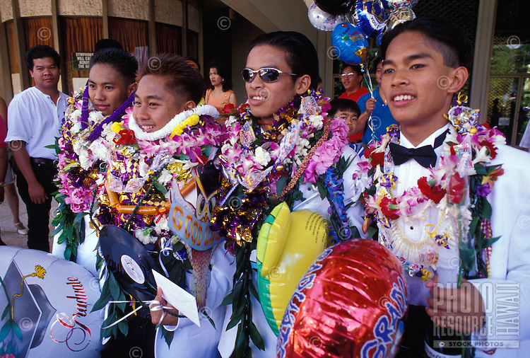 Students piled with leis for a high school graduation ceremony at the Neal Blaisdell Concert Hall, Honolulu