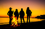Residents enjoy a beach fire during sunset at Shell Point Beach along the Forgotten Coast of the north Florida panhandle.