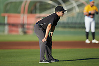 Umpire Josh Gilreath handles the calls on the bases during the South Atlantic League game between the Greensboro Grasshoppers and the Rapidos de Kannapolis at Kannapolis Intimidators Stadium on June 14, 2019 in Kannapolis, North Carolina. The Grasshoppers defeated the Rapidos de Kannapolis 4-1. (Brian Westerholt/Four Seam Images)