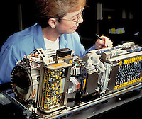 Defense industry electronics assembly. Lockheed Martin. female worker.