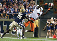 Miami wide receiver Aldarius Johnson makes a catch while being defended by Pitt defensive back Ricky Gary. The Miami Hurricanes defeated the Pittsburgh Panthers 31-3 at Heinz Field, Pittsburgh, Pennsylvania on September 23, 2010.