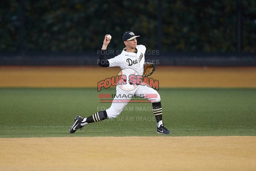 Wake Forest Demon Deacons second baseman Michael Turconi (6) makes a throw to first base against the North Carolina State Wolfpack at David F. Couch Ballpark on April 18, 2019 in  Winston-Salem, North Carolina. The Demon Deacons defeated the Wolfpack 7-3. (Brian Westerholt/Four Seam Images)