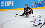 Sochi, RUSSIA - Mar 9 2014 -  Greg Westlake looks for make a pass during Canada vs. Norway at the 2014 Paralympic Winter Games in Sochi, Russia.  (Photo: Matthew Murnaghan/Canadian Paralympic Committee)