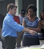 HOMESTEAD, FL - NOVEMBER 20:  Carl Edwards_First Lady Michelle Obama_Dr Jil Biden attends the NASCAR Sprint Cup Series Ford 400 at Homestead-Miami Speedway. First Lady Michelle Obama and Dr. Jill Biden giggled like a couple of schoolgirls when they met driver Carl Edwards in addition Obama seemed quite smitten and could not keep her hands off  driver Carl Edwards. The ladies also served as grand marshalls of the race. Ford 400.  On November 20, 2011 in Homestead.<br /> <br /> <br /> People:  Carl Edwards_First Lady Michelle Obama_Dr Jil Biden