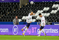 SWANSEA, WALES - NOVEMBER 12: John Brooks #6 of the United Sates clears a ball with his head during a game between Wales and USMNT at Liberty Stadium on November 12, 2020 in Swansea, Wales.