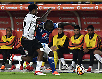 BOGOTA - COLOMBIA - 28 - 02 - 2018: Eliser Quiñones (Der.) jugador de Millonarios (COL), disputa el balon con Rene Junior (Izq.) jugador de Corinthians (BRA), durante partido entre Millonarios (COL) y Corinthians (BRA), de la fase de grupos, grupo 7, fecha 1 de la Copa Conmebol Libertadores 2018, en el estadio Nemesio Camacho El Campin, de la ciudad de Bogota. / Eliser Quiñones (R) player of Millonarios (COL), figths for the ball with Rene Junior (L) player of Corinthians (BRA), during a match between Millonarios (COL) and Corinthians (BRA), of the group stage, group 7, 1st date for the Conmebol Copa Libertadores 2018 in the Nemesio Camacho El Campin stadium in Bogota city. VizzorImage / Luis Ramirez / Staff.