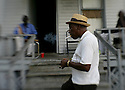 """Driving Detroit..J. R. (""""Snoop"""" ) Frazier, 67 , lights up at his friend's house at 1239 Concord St. just east of St. Paul,  on Sunday, October7, 2007. Frazier has lived in Detroit since 1943, and is retired from the Ford Motor Co. where he worked for 33 years."""