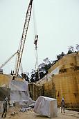 Espirito Santo State, Brazil. Sambra stone quarry; tripod crane lifting a large block of marble.