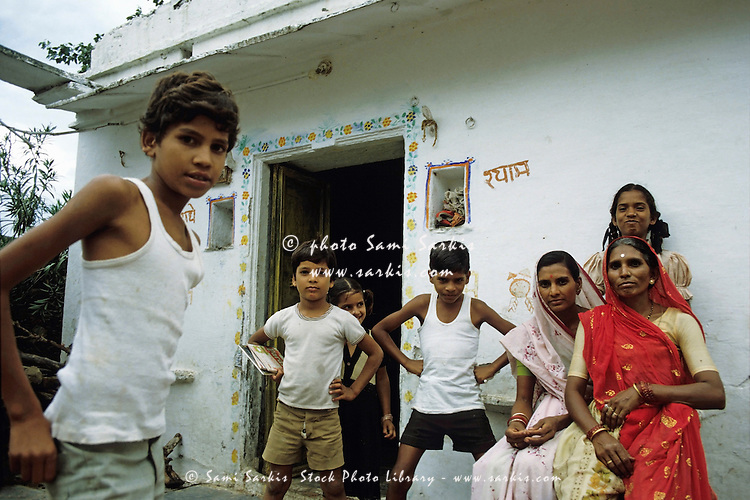 Portrait of an Indian family outside their house, Udaipur, Rajasthan, India.