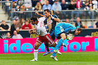 New York Red Bulls goalkeeper Luis Robles (31) collides with teammate  Rafa Marquez (4) and Danny Cruz (44) of the Philadelphia Union during a Major League Soccer (MLS) match at PPL Park in Chester, PA, on October 27, 2012.