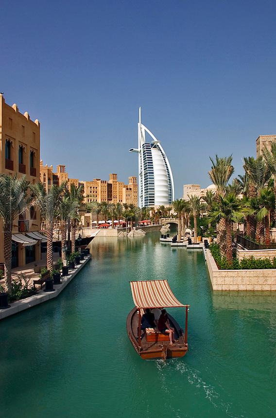 Dubai, United Arab Emirates. Madinat Jumeirah. Burj al Arab Hotel, .Mina A'Salam Hotel and Convention Centre. Water taxi. Abra..