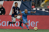 FOXBOROUGH, MA - SEPTEMBER 29: Alexandru Mitrita #28 of New York City FC dribbles down the wing as Brandon Bye #15 of New England Revolution defends during a game between New York City FC and New England Revolution at Gillette Stadium on September 29, 2019 in Foxborough, Massachusetts.