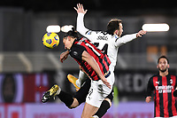 Zlatan Ibrahimovic of AC Milan and Ardian Ismajli of Spezia Calcio compete for the ball during the Serie A football match between Spezia Calcio and AC Milan at Spezia stadium in Spezia (Italy), February 13th, 2021. Photo Image Sport / Insidefoto