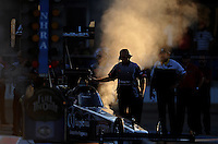 Sept. 23, 2011; Ennis, TX, USA: A crew member for NHRA top fuel dragster driver Rod Fuller makes an adjustment to the engine during qualifying for the Fall Nationals at the Texas Motorplex. Mandatory Credit: Mark J. Rebilas-
